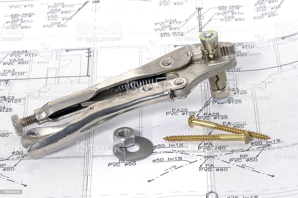 Lock grip pliers over house plan royalty-free stock photo