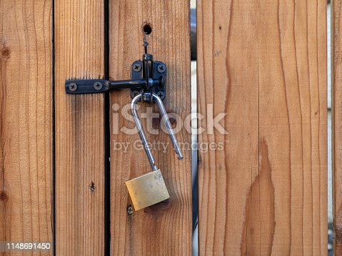 Lock hanging from a latch on a gate