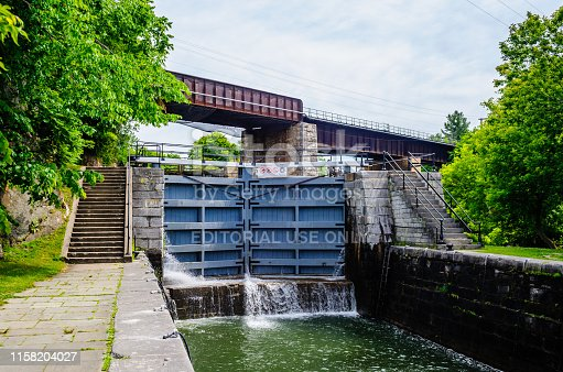 Kingston, Canada - June 20, 2018: One of the lower locks of the Kingston Mills Locks is part of the Rideau Canal which connects Ottawa to Lake Ontario.