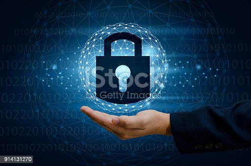 istock lock In the hands of a businessman Shield the shield to protect the cyberspace.Space input data Data Security Business Internet Concept. Secure information 914131270