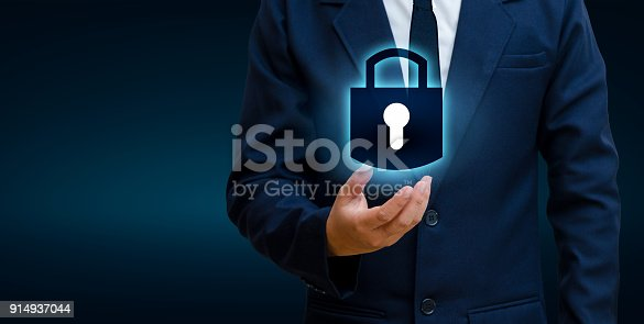 istock lock In the hands of a businessman Shield the shield to protect the cyberspace.Space input data Data Security Business Internet Concept. Secure information 914937044