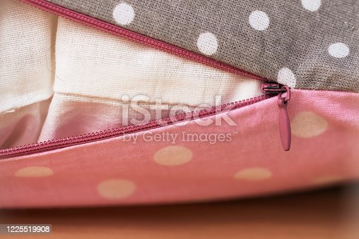 A lock on a baby pink pillow. pillowcase. subject photo. Cozy bed for a child