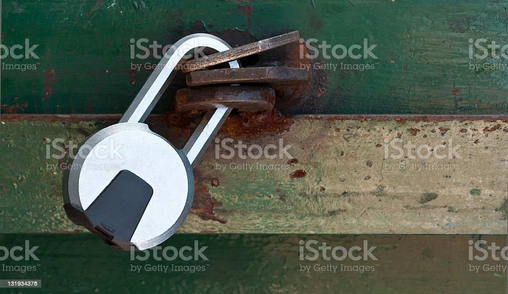 lock on a green rusted door royalty-free stock photo