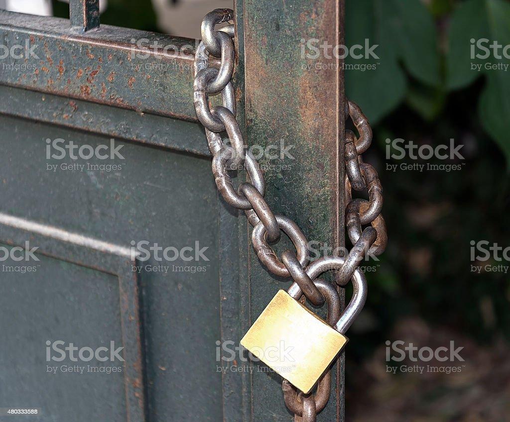 lock on a metal chain stock photo