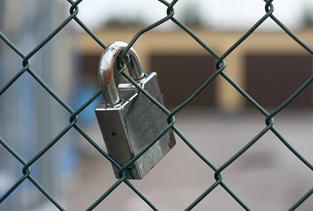 Lock on fence bildbanksfoto