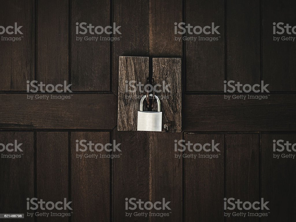 lock on wooden door stock photo