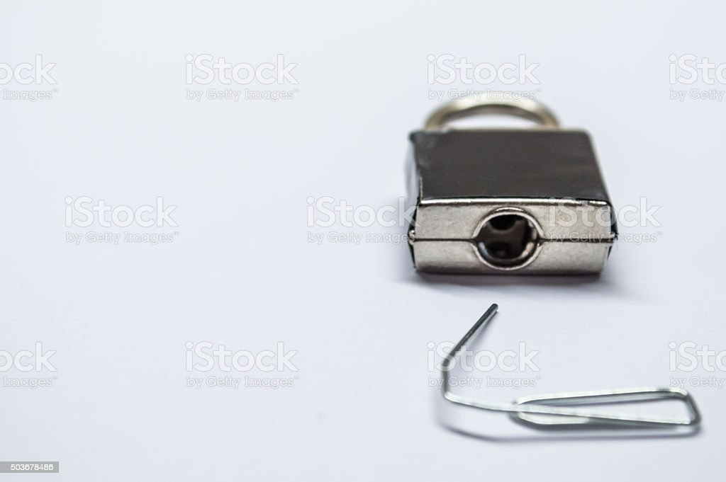 Lock Picking A Locked Padlock With A Paperclip Stock Photo