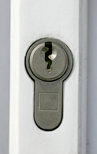 A macro picture of a door lock.  Very detailed at 100% you can see the detail on the metal of the lock.