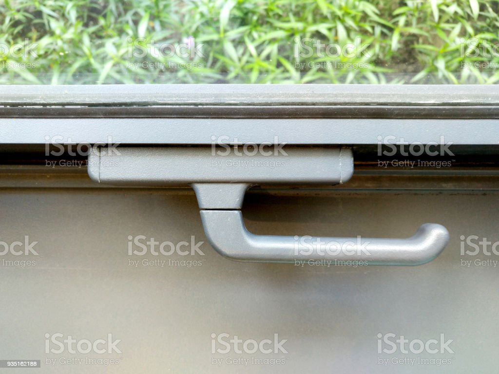Lock the window securely, to protect from insect, mosquito, pollutions (noise, gas, water) and from unknown person. (Lock and open Concept) stock photo