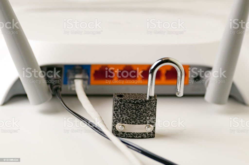 Lock unlock security .Protecting the Internet connection through a wi-fi router is a concept of a security breach. Cyber security. stock photo