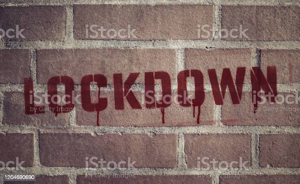 Lockdown Stencil Spraypainted On Brick Wall Stock Photo - Download Image Now