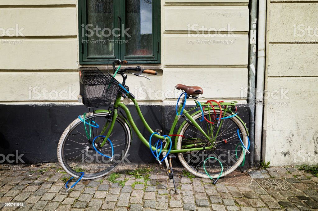 Locked bicycle on the street stock photo