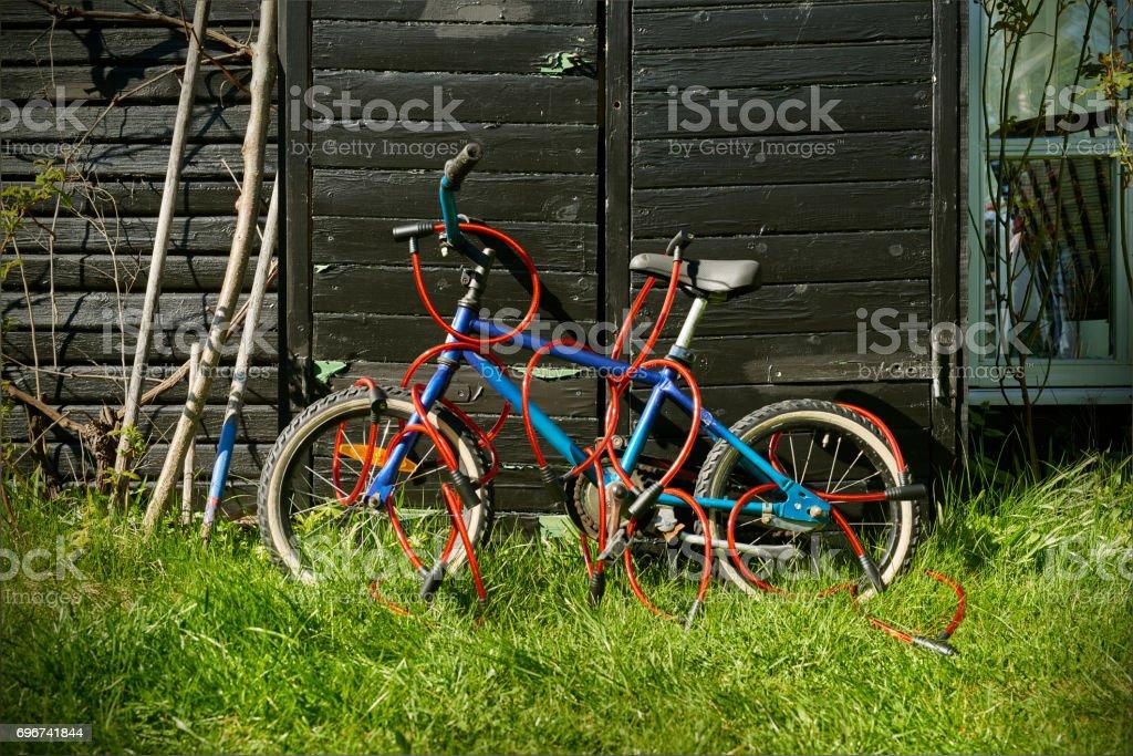 Locked childrens bike stock photo