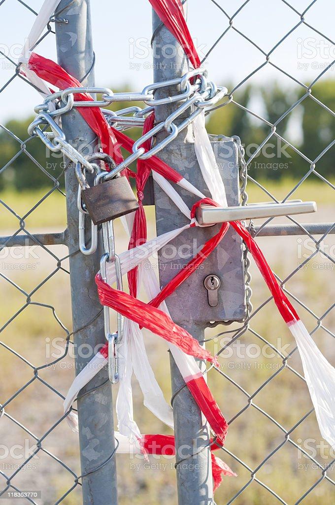 Locked door and barrier tape stock photo