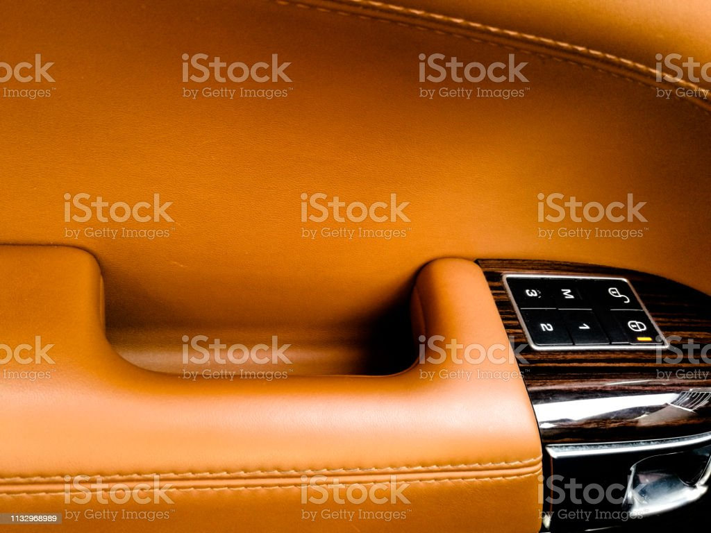 locked door of an exotic vehicle the interior is in brownish color of...