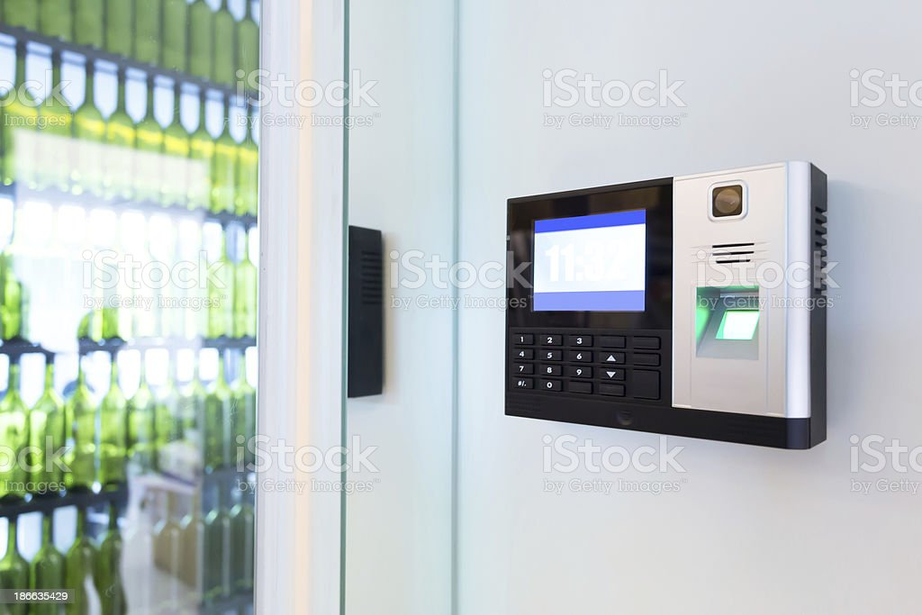 Locked door with security keypad for access stock photo