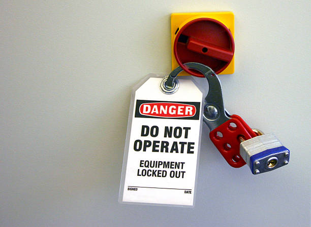 Locked equipment with locks and danger sign notice Lock Out Tag Out lockout stock pictures, royalty-free photos & images