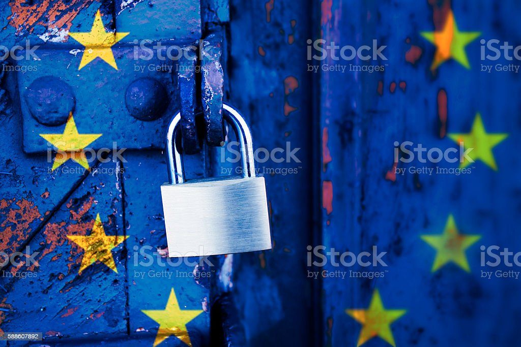 Locked europe, padlock on a door with the EU flag stock photo