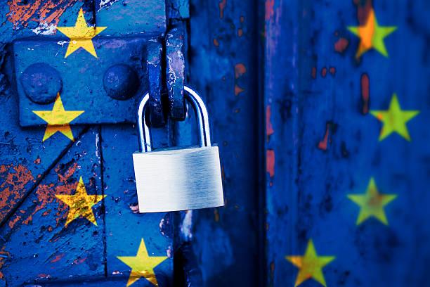 Locked europe, padlock on a door with the EU flag stock photo