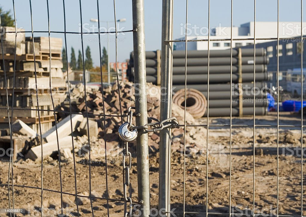 Locked fence at building site royalty-free stock photo