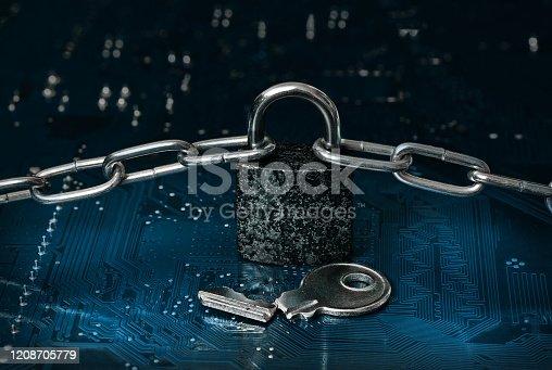 istock locked padlock, chain and broken key on computer circuit board 1208705779