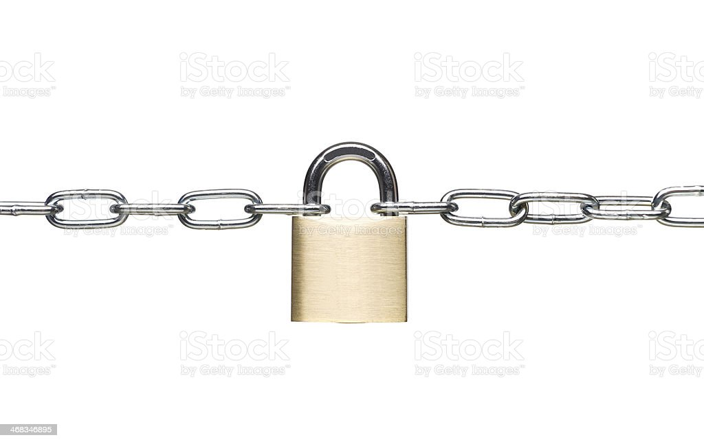 Locked padlock holds two links of chain together royalty-free stock photo