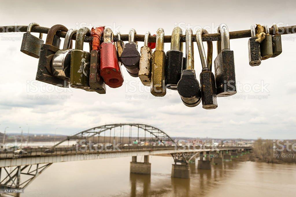 Locked Padlocks and a Bridge Construction stock photo