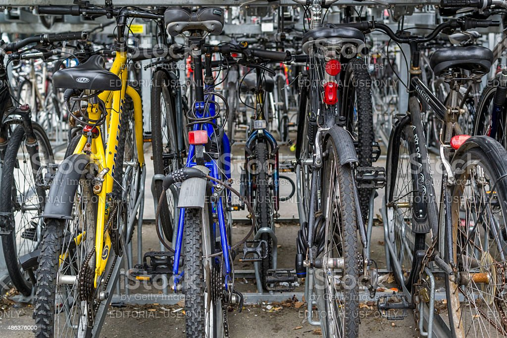 Locked Rows of Commuter Bikes at a Train Station stock photo