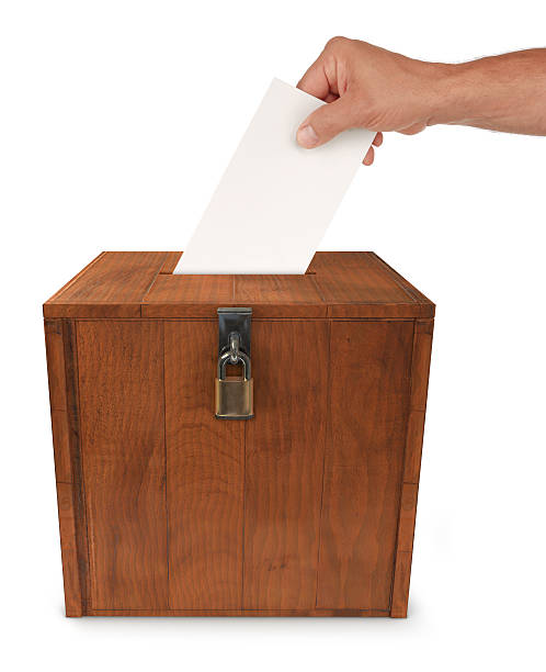 Locked wooden ballot box for election stock photo