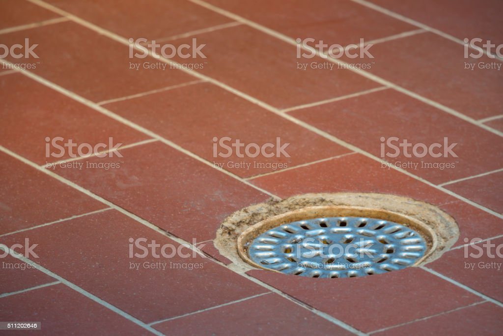 Locker room tiled floor and drain stock photo