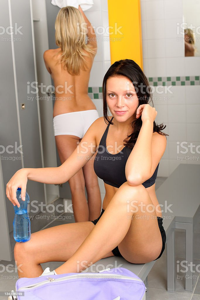 Locker room young sportive woman outfit sitting stock photo