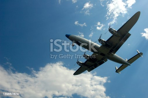 An old airliner, a Lockheed Constellation (N73544, built in 1955), on short finals.