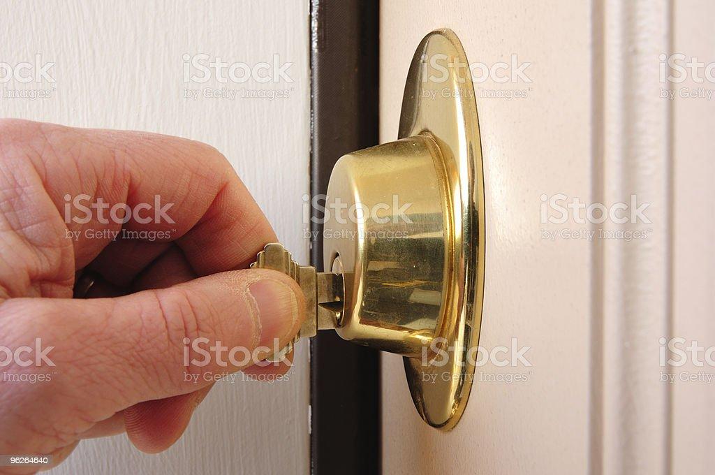 Locking a Deadbolt stock photo