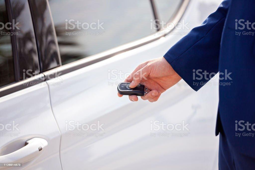 Locking Or Unlocking Car Door With Remote Key Stock Photo