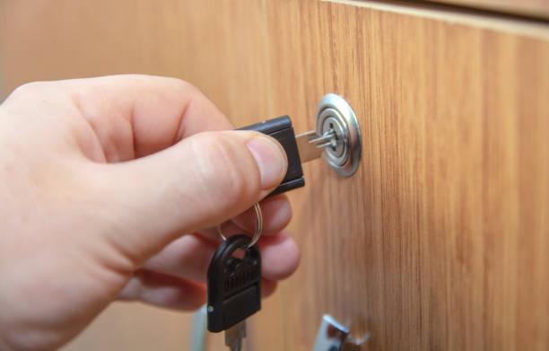 Locking the cabinets with key stock photo stock photo