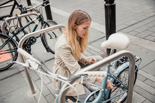 Locking up her Bicycle