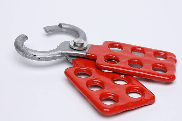 lockout tagout multiple lock hasp This is to be used so that multiple locks can lockout the same machine.  The machine cannot be turned back on until all of the locks are removed. lockout stock pictures, royalty-free photos & images