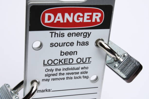 Lockout Tagout A lockout tagout tag with two locks on it lockout stock pictures, royalty-free photos & images