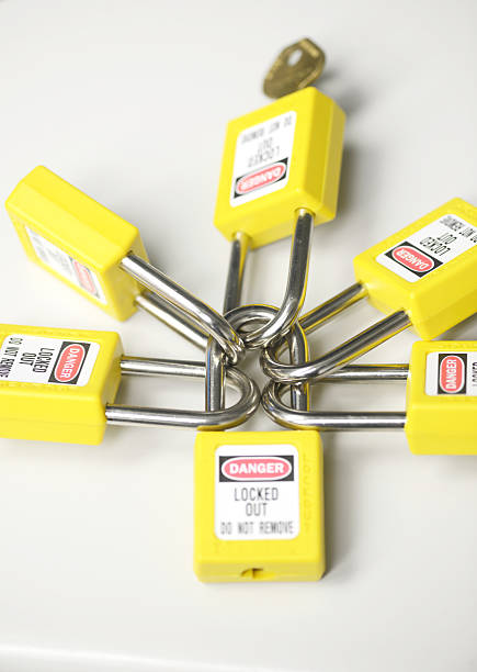 lockout tagout Lockout tagout program locks lockout stock pictures, royalty-free photos & images