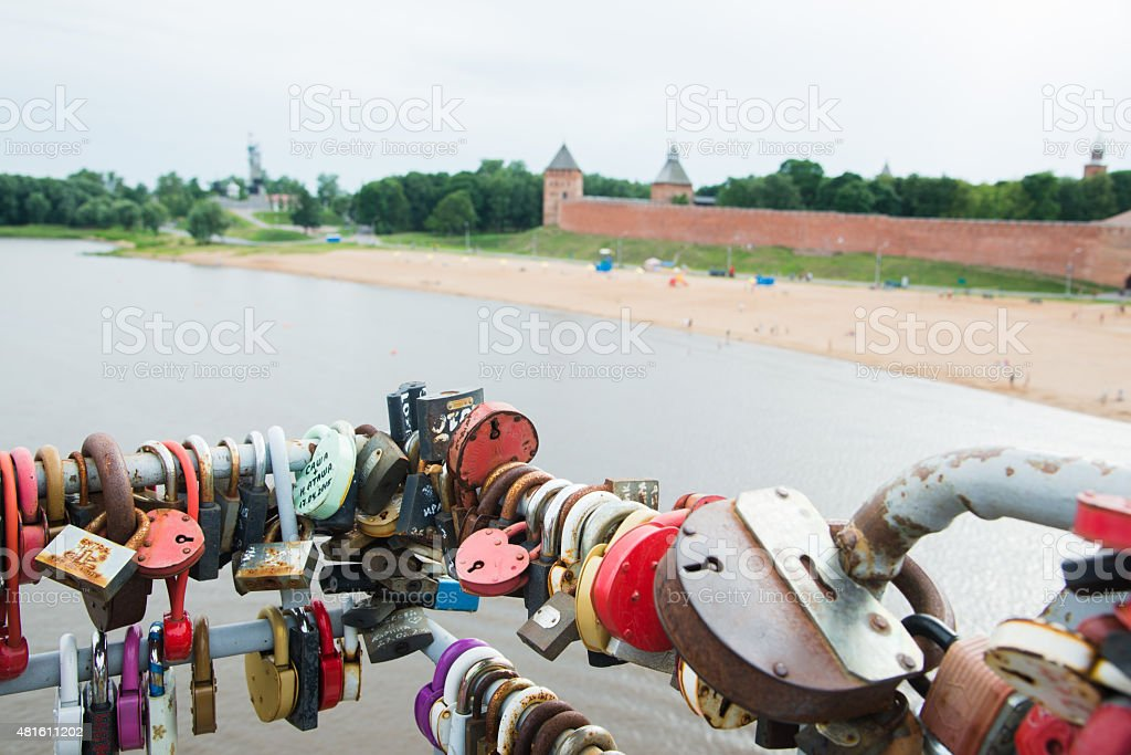 Locks attached on railing of a pedestrian bridge stock photo