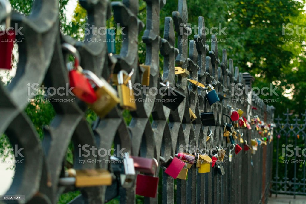 locks of lovers on the iron fence near the river on the bridge, as a symbol of marriage ties - Royalty-free Bridge - Built Structure Stock Photo