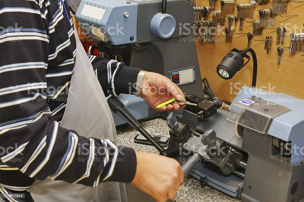 Locksmith at work....making spare key royalty-free stock photo
