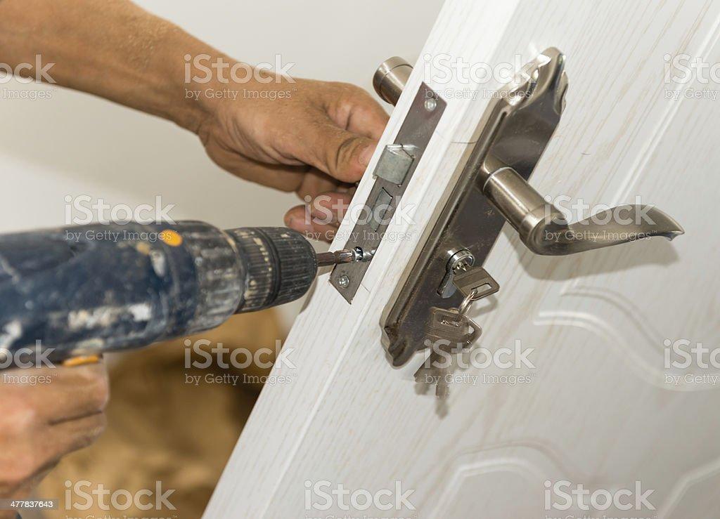 Locksmith Installation Changing Door Locks stock photo