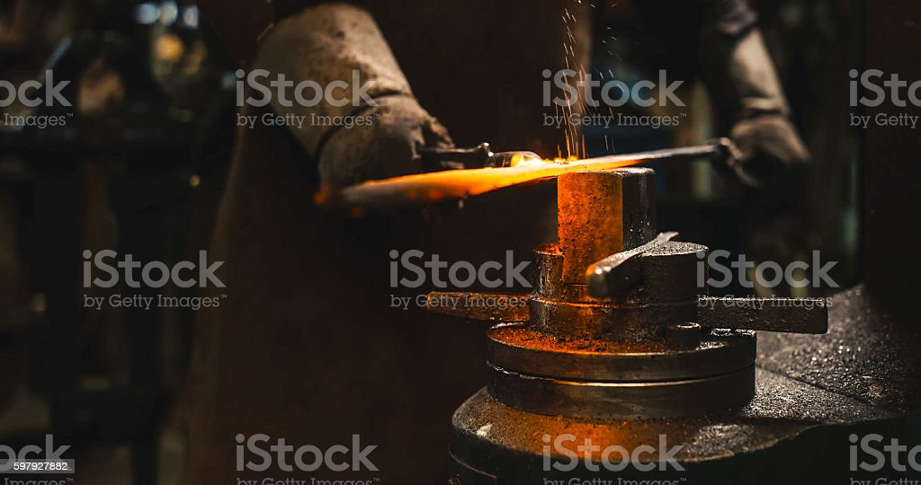 Locksmith working hot iron. stock photo