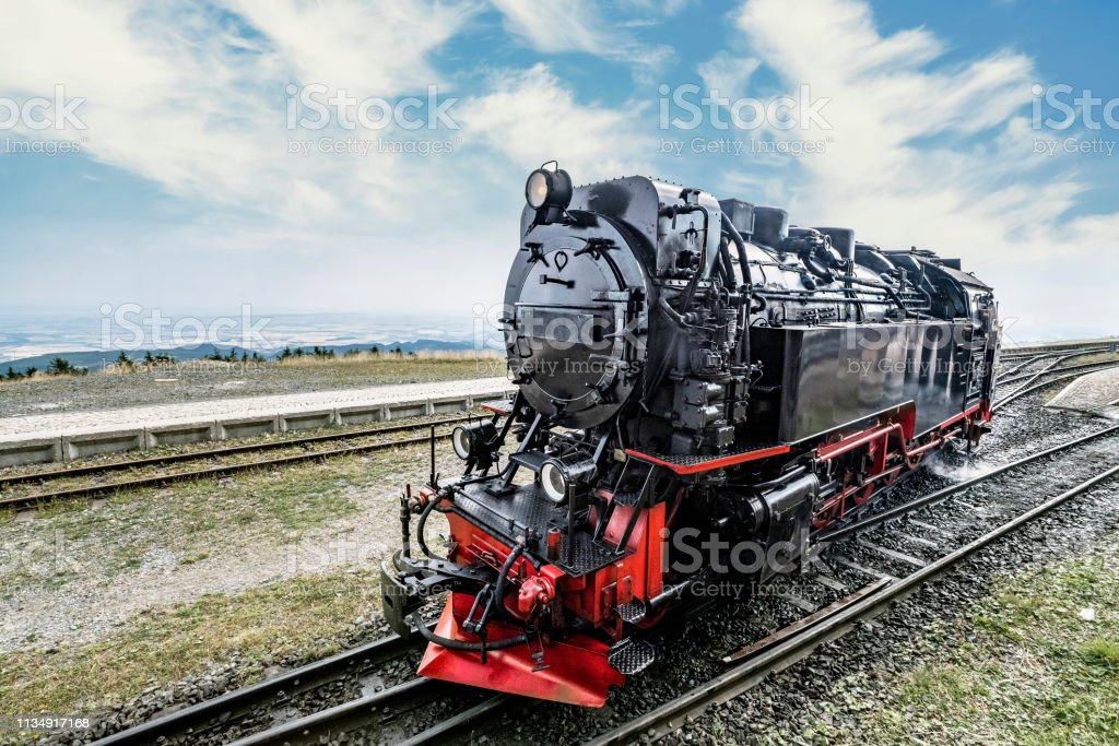 Locomotive on railroad tracks at a station stock photo