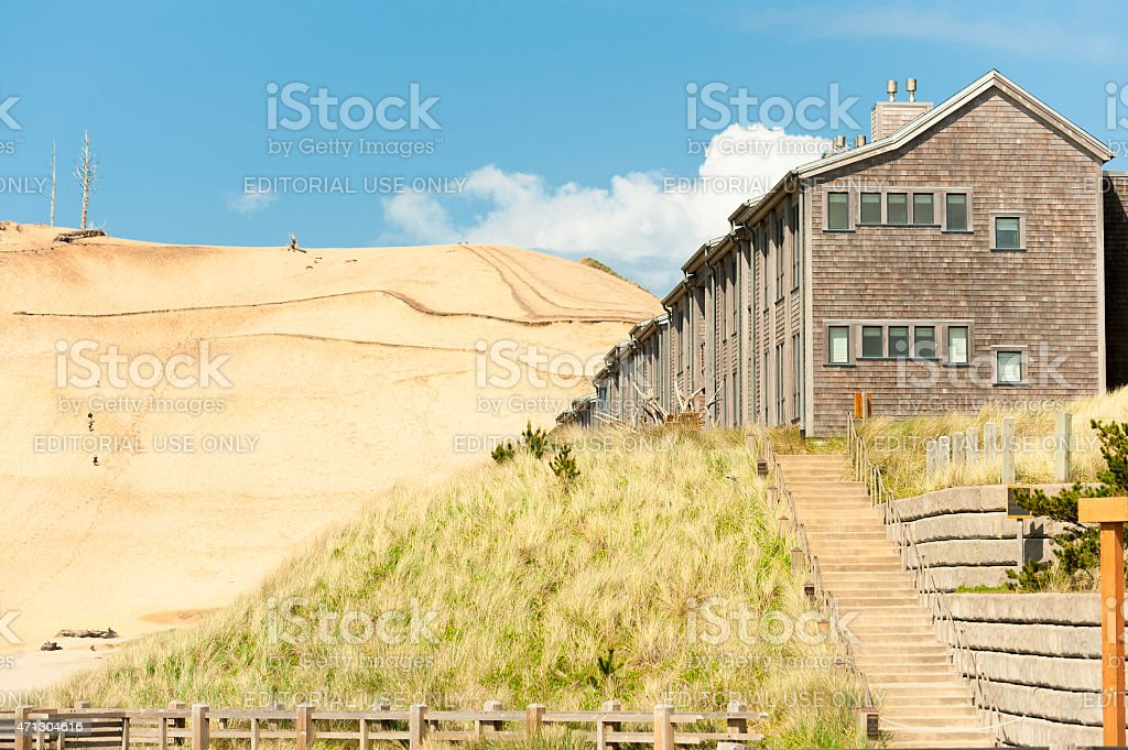 Lodging at Pacific City with sand hill in background stock photo