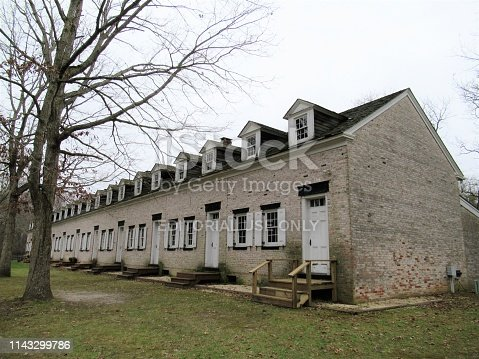 Row of lodgings at Allaire Village, New Jersey, USA. Allaire Village is a living history museum (free entrance). The village was established as a bog iron furnace originally known as Monmouth Furnace and then Howell Works. In 1822, it was purchased by philanthropist James P. Allaire, who endeavored to turn the furnace into a self-contained community.