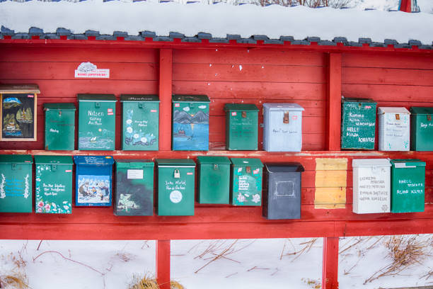 Lofoten Islands- Norway, March 23, 2017: Line of Old Post Office Boxes Places on Wooden Stand on Lofoten Islands, Norway in March 23, 2017