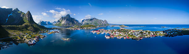 Lofoten panorama Scenic aerial panorama of fishing town Reine and surrounding fjords on Lofoten islands in Norway, famous for its breathtaking scenery lofoten stock pictures, royalty-free photos & images