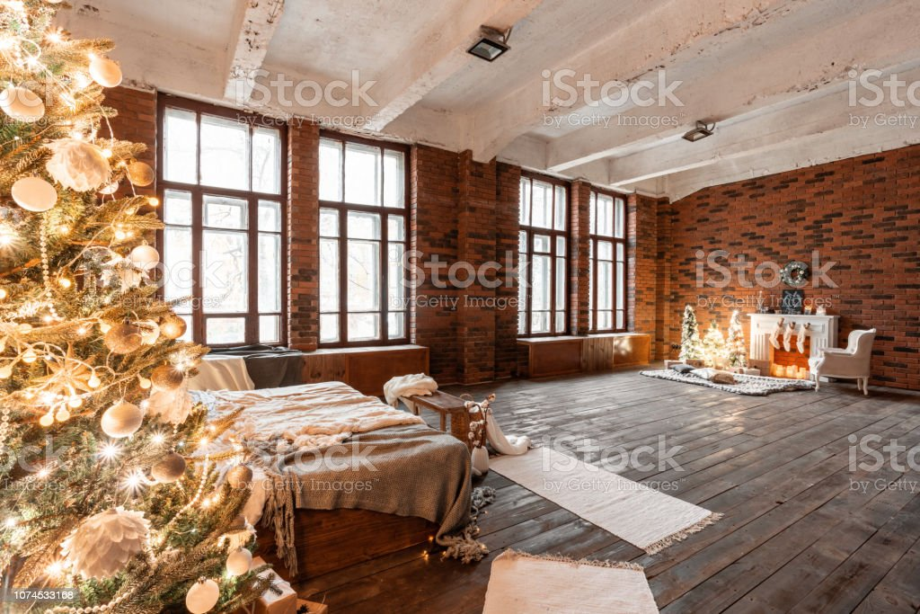 Loft Apartments Brick Wall With Candles And Christmas Tree ...